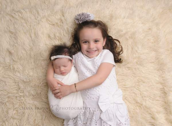 newborn baby and sister in Baltimore