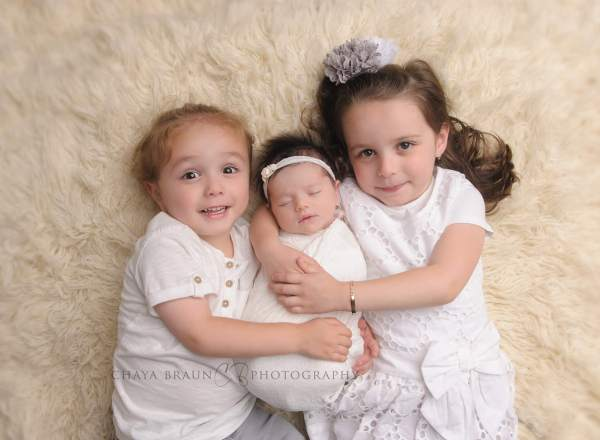 newborn baby and sister and brother photo