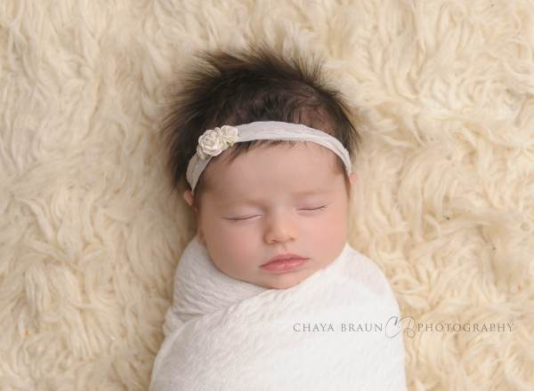 newborn baby with long gorgeous hair