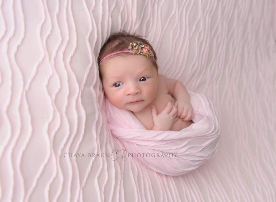 awake newborn baby girl