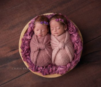 smiling twin newborn babies