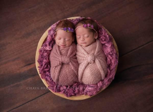 smiling twin newborn babies