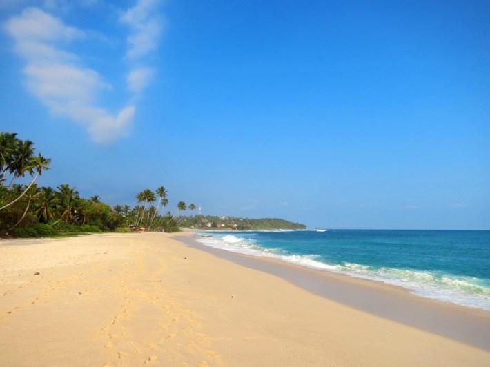 Empty wide clean beach with palms, Kamburugamuwa, Mirissa, Sri Lanka
