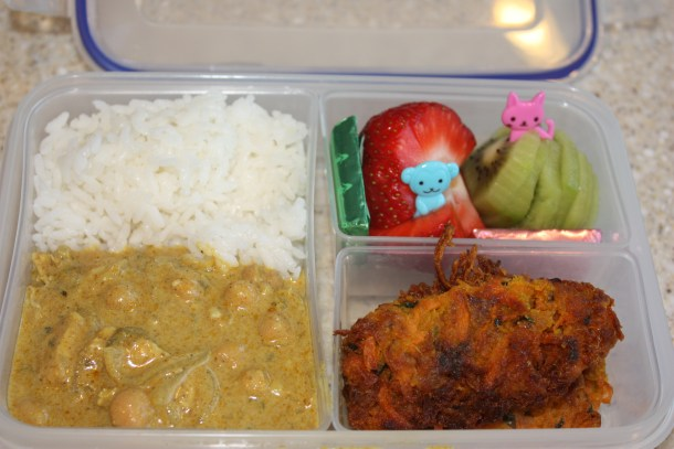 Packing Healthy Lunches on the Cheap: leftovers from Indian curry and sliced fruit