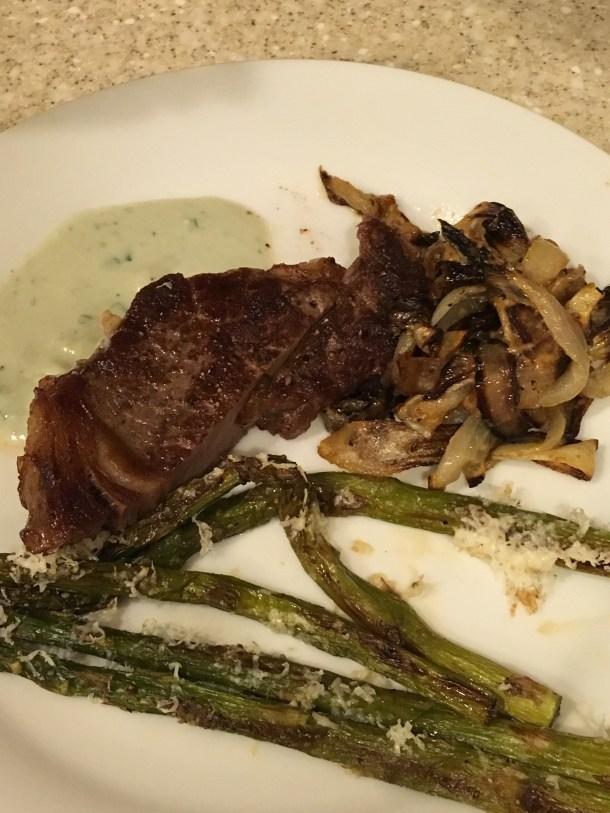 Rib eyes, roast asparagus with Parmesan, cream and thyme roast onions
