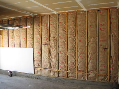 Insulated wall with one drywall panel in place