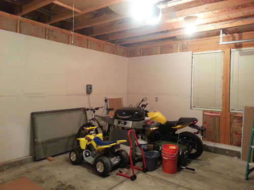 Installing drywall on the garage walls