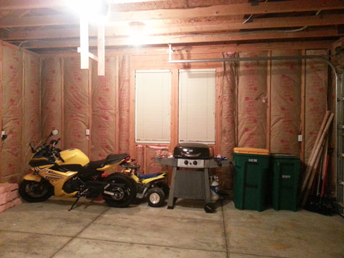 Finishing the garage walls, most of the insulation in place
