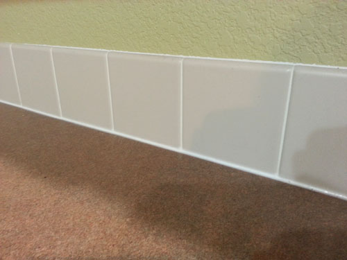 Laminate countertops and tile mini-backsplash