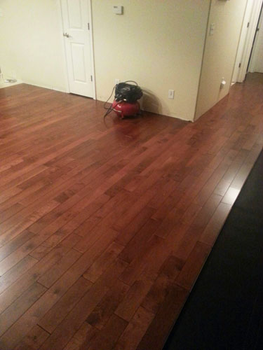 more than half-way-done-installing-hardwood-flooring