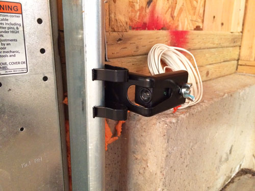 Installing a garage door opener safety sensor