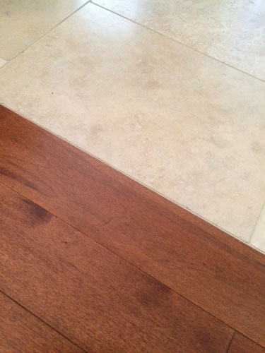 Travetine tile-hardwood transition