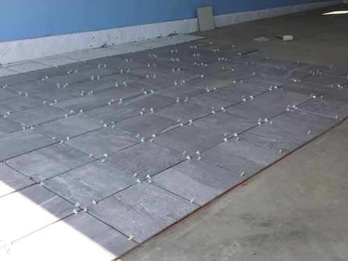 Laying A Porcelain Tile Garage Floor Cheapest House On The Block