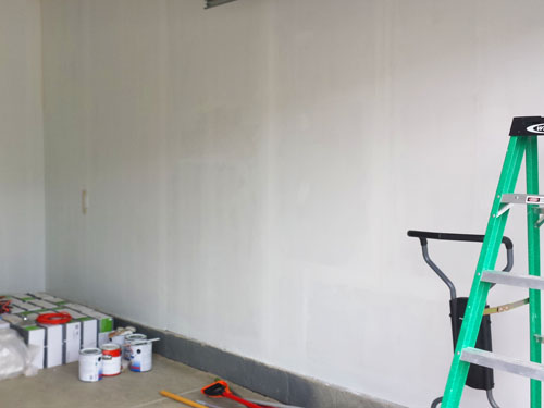 Priming the right side garage walls