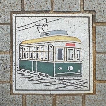 Streetcar drawing on a sidewalk in Hiroshima - Hiroshima, Japan