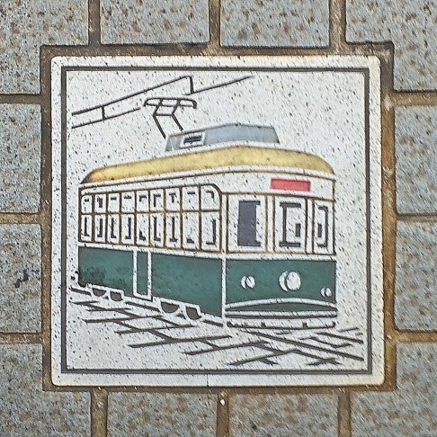 Streetcar drawing on a sidewalk in Hiroshima - Hiroshima, Japan