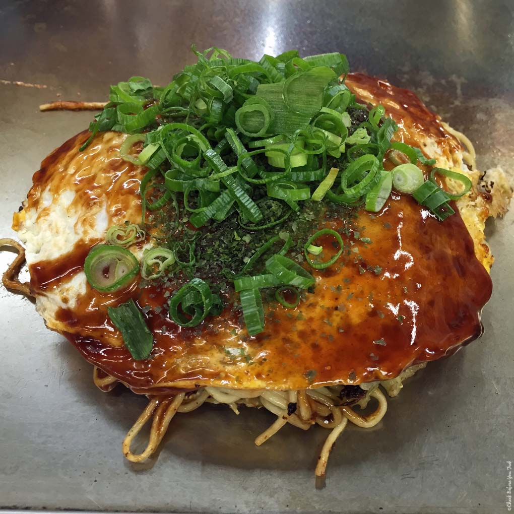 Okonomiyaki from a food stall in Okonomimura - Hiroshima, Japan