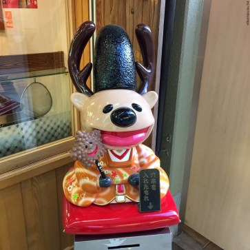 Mascot for a street food vendor in Miyajima - Miyajima Island, Itsukushima, Japan