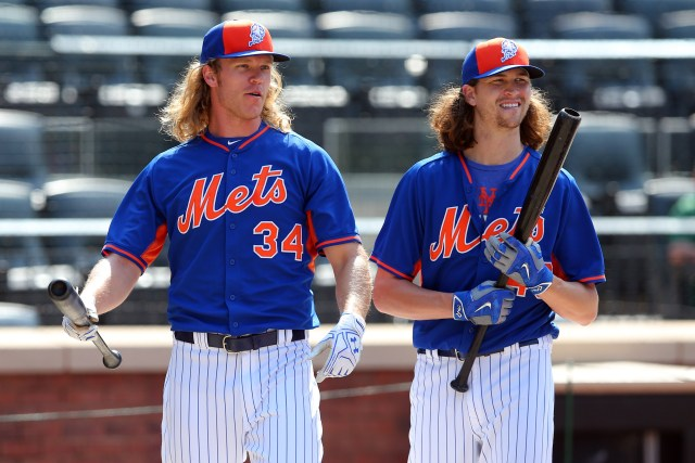 May 31, 2016; New York City, NY, USA; New York Mets pitchers Noah Syndergaard (34) and Jacob deGrom (48) during batting practice before a game against the Chicago White Sox at Citi Field. Mandatory Credit: Brad Penner-USA TODAY Sports