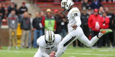 Oct 31, 2015; Cincinnati, OH, USA; UCF Knights place kicker Donald Delahaye (19) kicks an extra point in the second half against the Cincinnati Bearcats at Nippert Stadium. The Bearcats won 52-7. Mandatory Credit: Aaron Doster-USA TODAY Sports