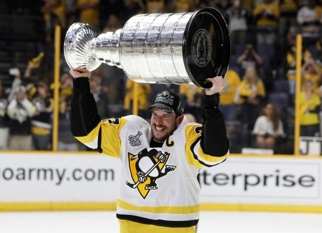 Pittsburgh Penguins' Sidney Crosby (87) celebrates with the Stanley Cup after defeating the Nashville Predators in Game 6 of the NHL hockey Stanley Cup Final, Sunday, June 11, 2017, in Nashville, Tenn. (AP Photo/Mark Humphrey)