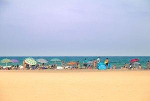 Umbrellas and beachgoers relaxing