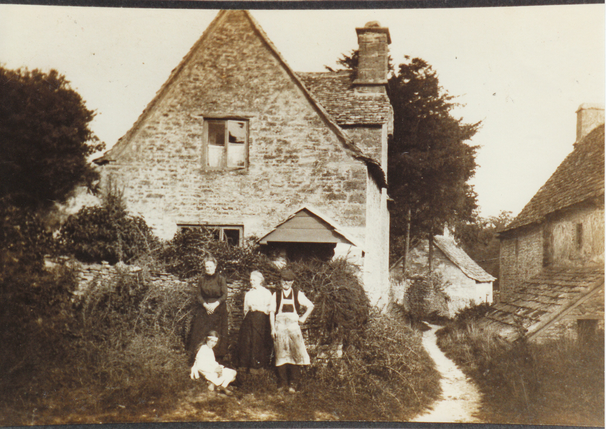 Badger's Cottage, Gadbridge. John Collett - probably the last of the Chedworth shoemakers outside his cottage.