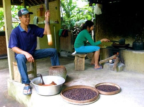 Kopi Luwak coffee cleaning process wooden mortar pestle bali indonesia