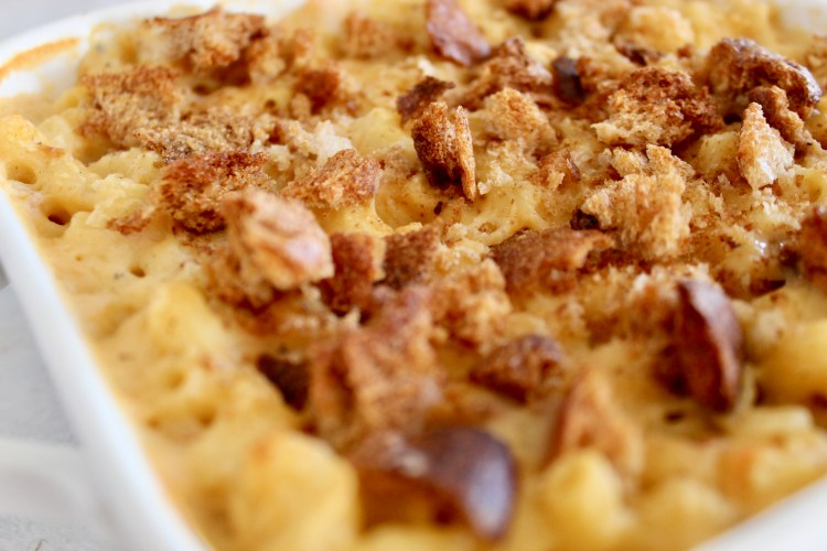 Sharp cheddar, muenster, and asiago makes for an indulgent, three cheese Homemade Breadcrumb Baked Mac and Cheese. Some simple healthy recipe swaps help reduce the fat, maintain the protein and increase the fiber content of this classic recipe. #macandcheese #healthier #wholegrain #cheesy #dinner #CheerfulChoices