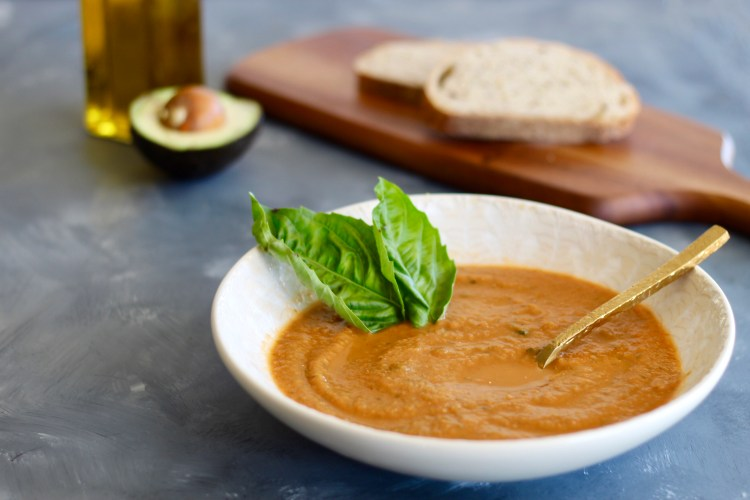 This homemade Tomato Basil Soup is juicy, flavorful, and simple to blend up. The perfect soup recipe to enjoy with seasonal or canned tomatoes! Serve with avocados, parmesan cheese, and whole grain bread.