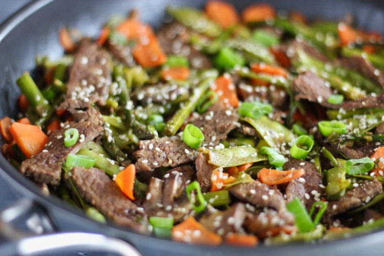 Incorporate seasonal ingredients like carrots, peas, and asparagus into this super quick Vegetable and Flank Steak Stir Fry. A perfect protein and veggie-packed recipe to whip up for your next meal.