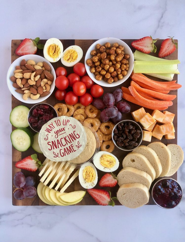Learn how to make a picture-worthy snack board with whatever bits of food you have in your fridge or pantry. It's a fun at home activity and a great way to reduce food waste! #athomeactivity #snackboard #charcuterie #nofoodwaste #vegetarian
