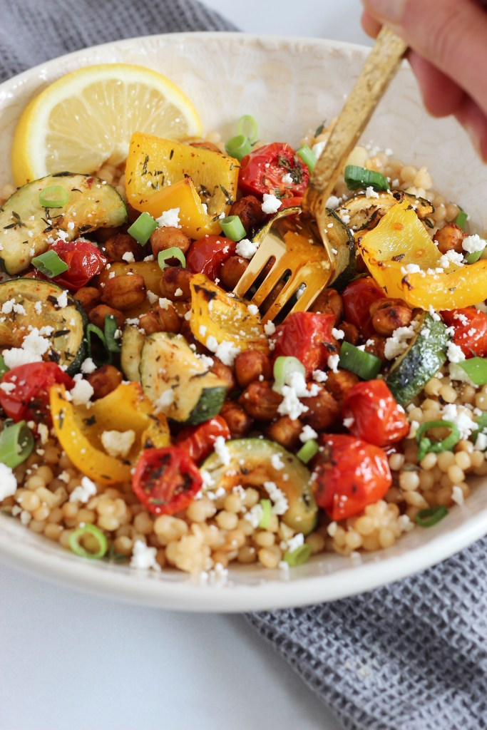 Look for a satisfying meatless meal? Try these Roasted Chickpea Couscous Bowls! This Mediterranean-inspired, vegetarian meal is made with Israeli couscous, colorful veggies, and crispy chickpeas. #IsraeliCouscous #Mediterranean #MeatlessMonday #Vegetarian #HealthyRecipes #RoastedChickpeas