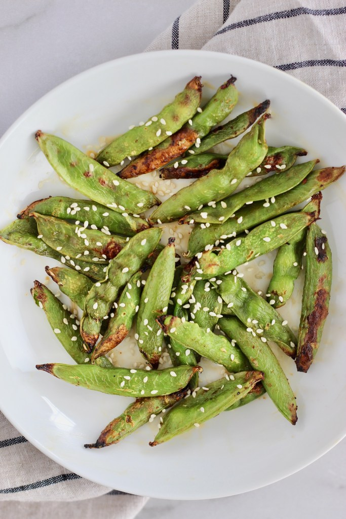 Close up of bright green air fried snap peas