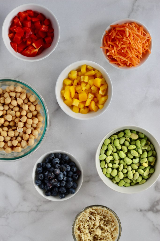 Colorful ingredients on top of white marble background