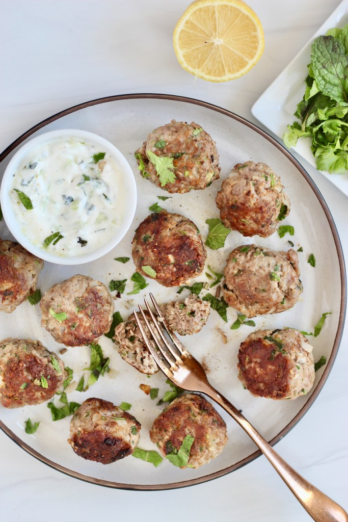 Lamb meatballs with a gold fork