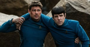 spock and mccoy in blue uniforms, spock leaning on mccoy as if hurt