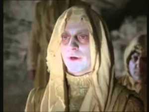 pale man in yellow cloak