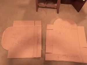 cardboard cut into a template to make tombstones
