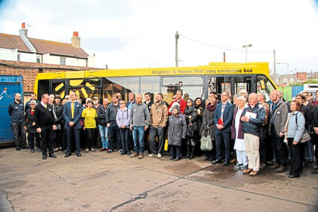 The-solar-powered-bus-the-Big-Lemon-team-and-some-of-their-many-guests-celebrate-the-launch-of-the-service