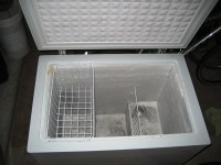 Small chest freezer for cheese cave, freezing mode, note frost buildup.