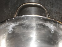 Stockpot after used as saturated brine bath tank, handle rivets erroding.