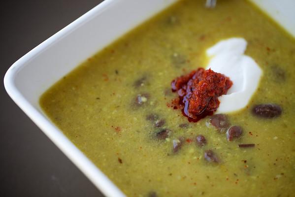 Garlic-saffron soup with harissa, greek yogurt and beans