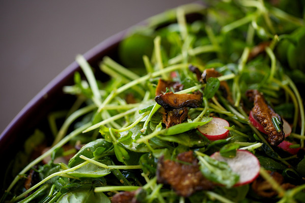 Spinach and pea shoots with roasted mushrooms, radishes and mustard dressing