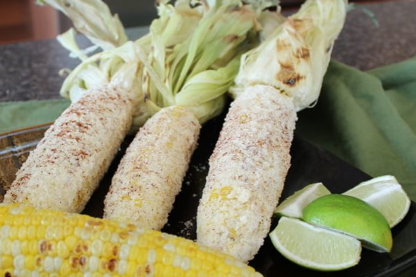 Cuban Sweet Corn with Parmesan and Lime....don't you dare knock it 'til you try it! I confess, plain ol' sweet corn with butter, salt, and pepper is divine, but THIS recipe is heaven on a plate!