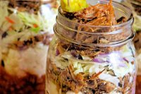 If you love barbecue as much as my family does, these Pulled Pork Parfaits are going to be a big hit. This savory specialty will put other bbq favorites to shame! Juicy pulled pork, crisp, crunchy coleslaw, sweet baked beans, and creamy mashed potatoes....all the flavors of a backyard barbecue... in a jar! #bbq #barbeque #pulledpork #pork #summer #parfait #easy #speedymeal