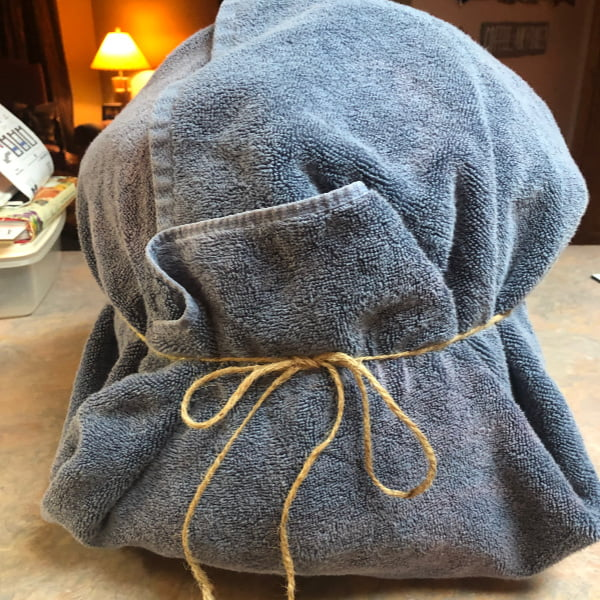 Instant Pot wrapped in a blue towel