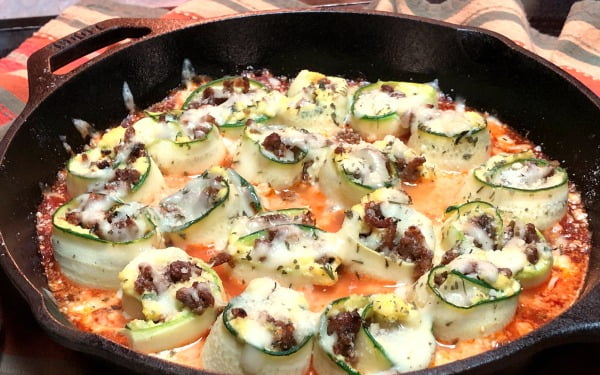 Are you craving the perfect blend of vegetables, meat, and sauce? This Skillet-Baked Zucchini Lasagna Roll-Up is a low-carb one-skillet meal. I was totally shocked by how delicious this meal is! The texture is identical to lasagna and you don't miss the pasta at all! #lowcarb #lasagna #zucchini
