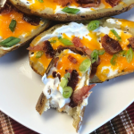 If you're looking for the perfect party appetizer, guess what??  You've just located it! Everybody seems to love these little boats of heavenly goodness - crispy skins, cheddar cheese, bacon, scallions and sour cream.