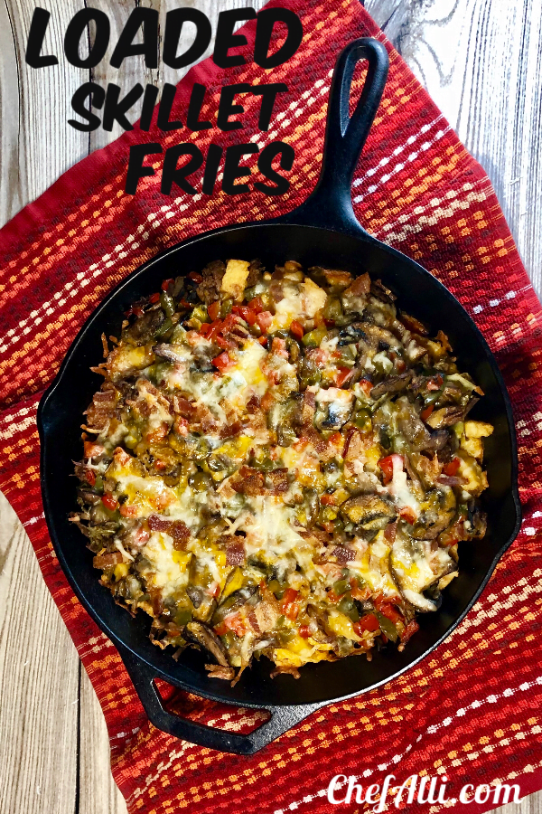 Who doesn't love a big ole skillet of loaded cheese fries?? Nobody, that's who. These Loaded Skillet Fries with Beef and Bacon are topped with gooey cheese, tender shredded beef, and crispy bacon to make the perfect party appetizer recipe, all layered up and baked in my favorite Lodge cast iron skillet.